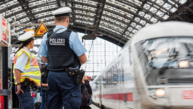 Two police officers patrolling a station (refer to: Federal Police)