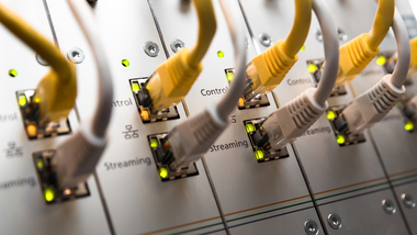 Several grey and yellow network wires (refer to: Digital Agenda)