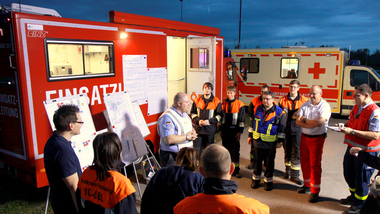 Rescue workers, firefighters and staff members of the Federal Technical Relief Agency coordinating an operation (refer to: Crisis management)
