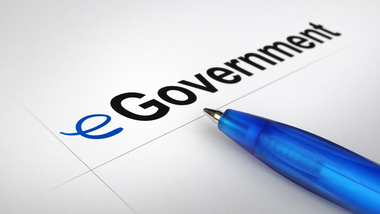 Ballpoint pen lying on a piece of paper featuring the word eGovernment  (refer to: E-government)