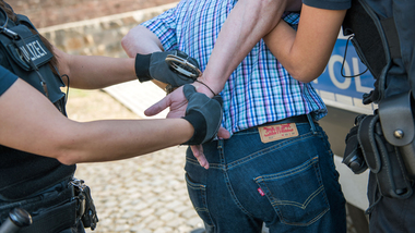 Police officers arresting a person (refer to: Crime)